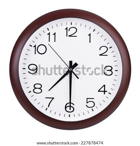 Round office clock shows half past seven - stock photo