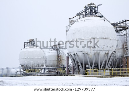 round oil tanks under snow cover