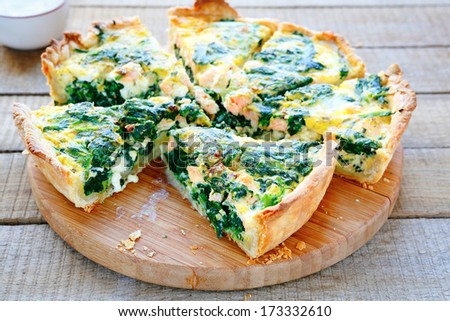 Round PIE with spinach and fish, food closeupop - stock photo