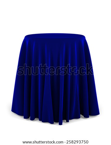 Round presentation pedestal covered with a blue cloth over white background - stock photo
