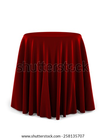 Round presentation pedestal covered with a red cloth over white background