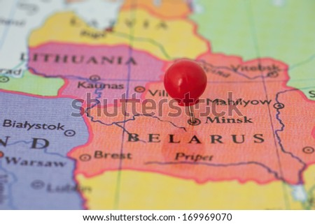 Round Red Thumb Tack Pinched Through City Of Minsk On Belarus Map Part Of Collection