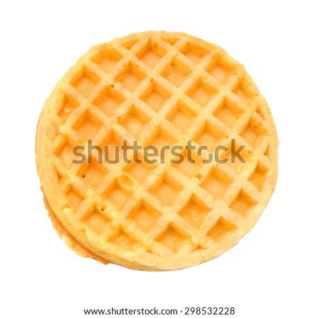 Round ruddy waffle isolated on white background - stock photo