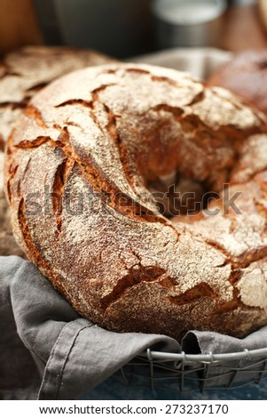 Round rye bread on a napkin, food