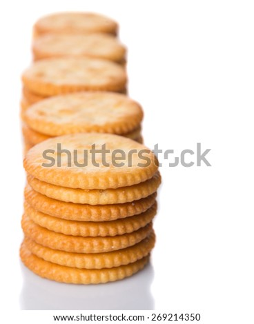 Round salted cracker over white background