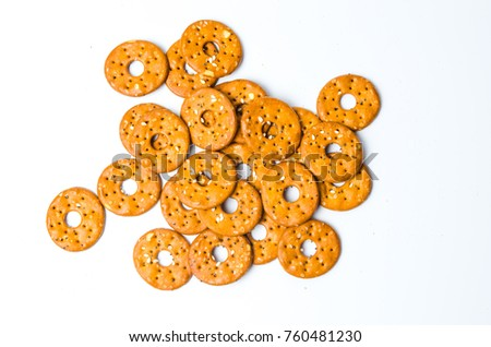 Round salty pretzels isolated on white background