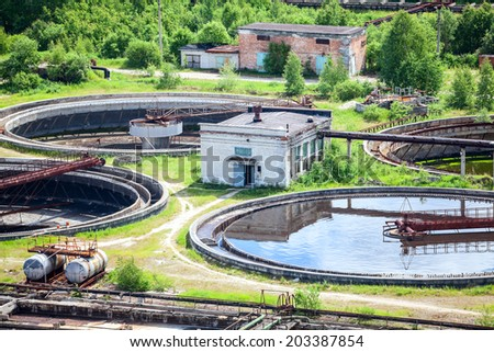 Round settlers at sewage treatment plant, aerial view - stock photo