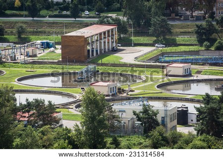 Round settlers at sewage treatment plant, aerial view. - stock photo