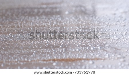 round shape droplets on clear plastic wrap which cover wood furniture