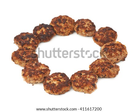 Round shape made of prepared small hand made cutlets isolated over white background - stock photo