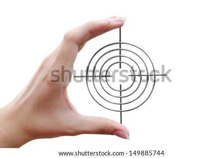 Round sight with crosshairs in hand on white background - stock photo