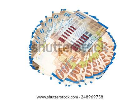 Round stack of new one hundred israeli sheqel isolated on white background - stock photo
