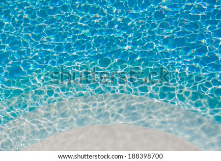 Round stair in a turquoise pool. Background. - stock photo