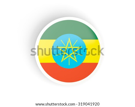 Round sticker with flag of ethiopia isolated on white