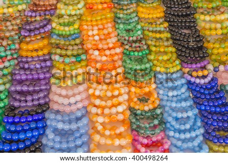 Round stone bracelet and glass beads fashion background