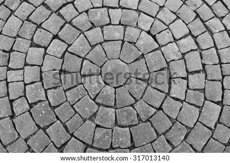 Round stone pavement pattern. Top view of black stone pavement texture
