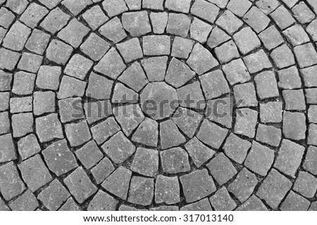 Round stone pavement pattern. Top view of black stone pavement texture - stock photo