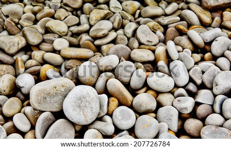 Round stones half in water - stock photo