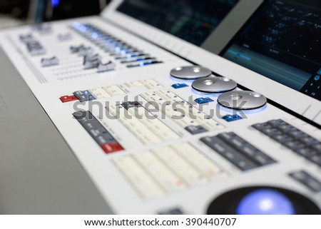 Round switchers of the white Hi-End stage controller - closeup background