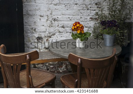 Round table and two chairs - stock photo