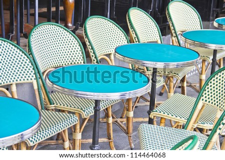 Round tables in a cafe in Paris - stock photo