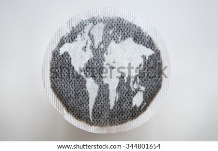 round tea bag with tea leaves in the shape of  - stock photo