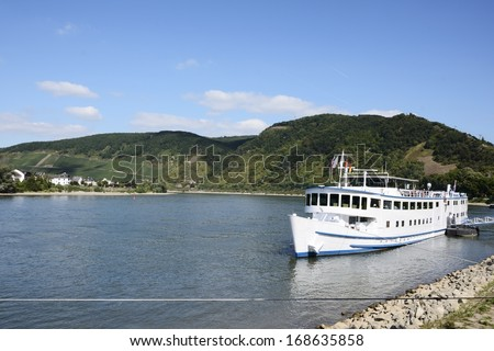 Round trip ship in the port at the river Rhine in Germany - stock photo
