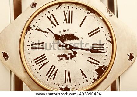 Round vintage wall clock, close up - stock photo