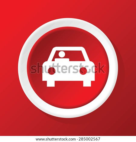 Round white icon with image of car with driver, on red background