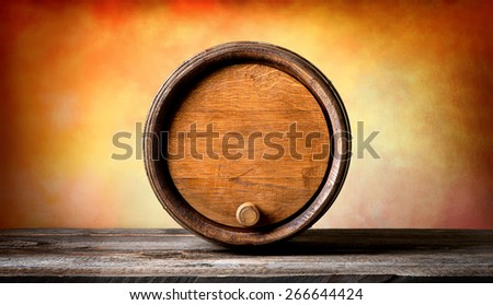 Round wooden barrel on a colored background - stock photo
