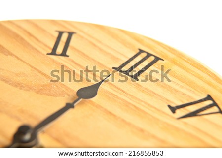 Round wooden clock close up
