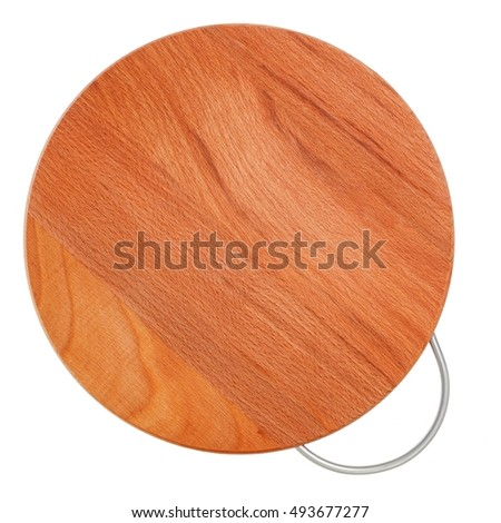 Round wooden cutting board with a metal handle. Top view. Stand for hot.