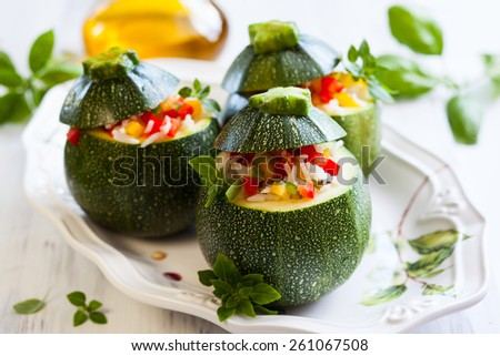 Round zucchini stuffed with vegetables and rice. - stock photo