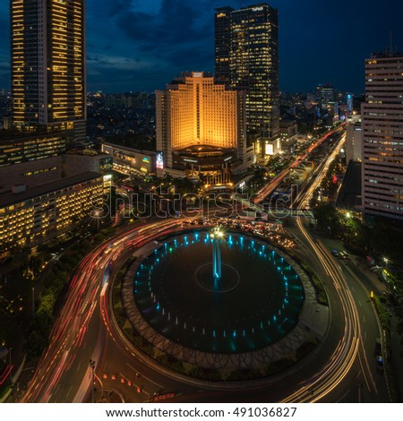 Roundabout Hotel Indonesia, Jakarta, Indonesia - September 28, 2016 : After sunset in the business district of Jakarta taken from the rooftop of the Mandarin Oriental hotel