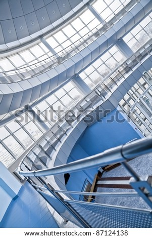 rounded balconies in an interior of modern office building - stock photo