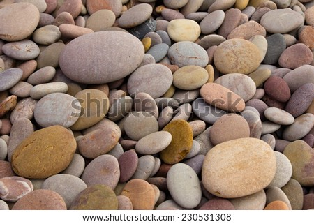 Rounded pebbles at the beach - stock photo