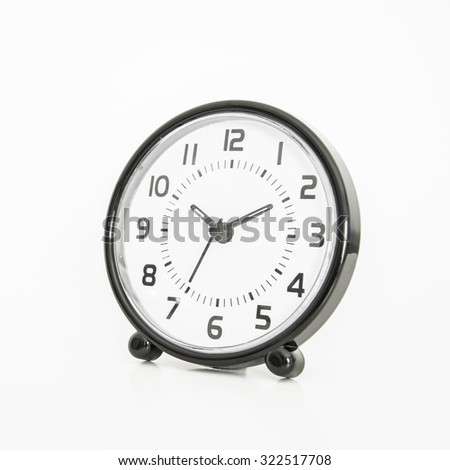 Rounded shape alarm clock on white background