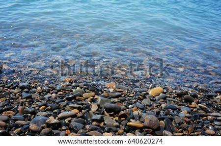 rounded stones in water