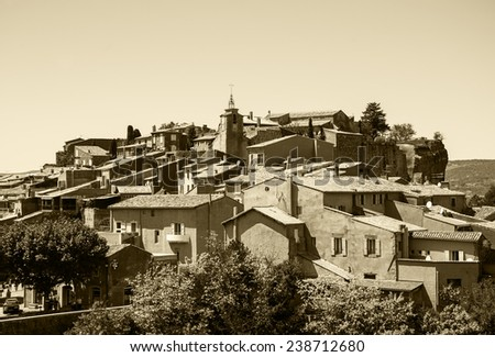 "Roussillon ocher village (included in the list of ""The most beautiful villages of France""). Provence Alpes Cote d'Azur, France. Aged photo. Sepia.  - stock photo"