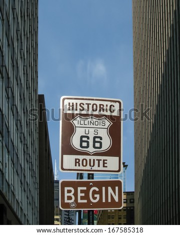 Route 66: An Illinois / US 66 road shield, marking the beginning of historic Route 66, leading through Chicago, Illinois. - stock photo