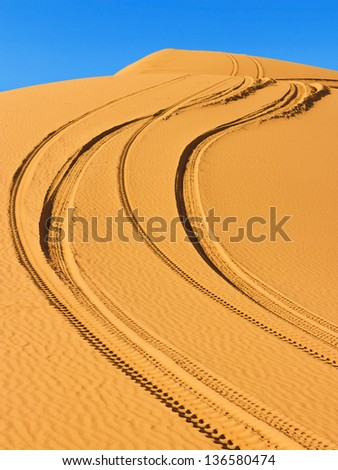 Route in the dunes of Sahara desert in Morocco - stock photo