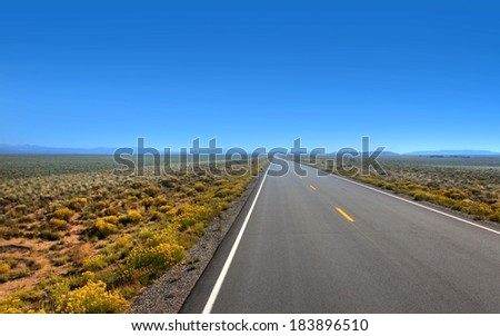 Route 150 is a straight road to Great sand dunes in Colorado - stock photo