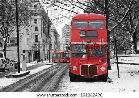 Route Master Bus in the street of London. Route Master Bus is the most iconic symbol of London as well as London's Black cabs. - stock photo