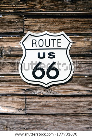 Route 66 sign on wooden pattern - stock photo
