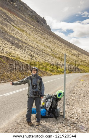 Route to Latrabjarg - young women  hitchhiking on Iceland.