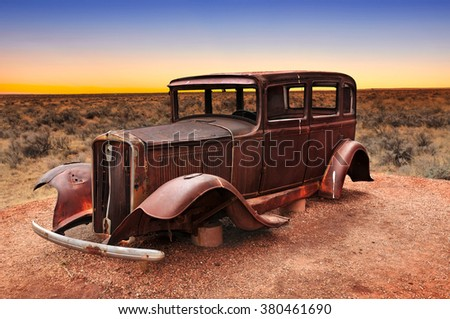 Route 66 vintage car relic displayed near the north entrance of Petrified Forest National Park in Arizona, USA - stock photo
