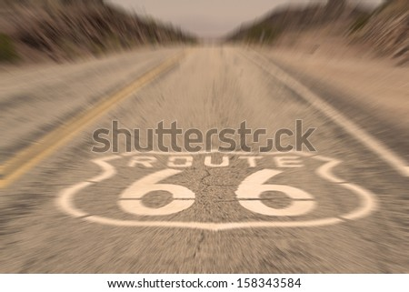 Route 66 Vintage - vertical image of route 66 road leading towards the distant horizon - motion blur  - stock photo