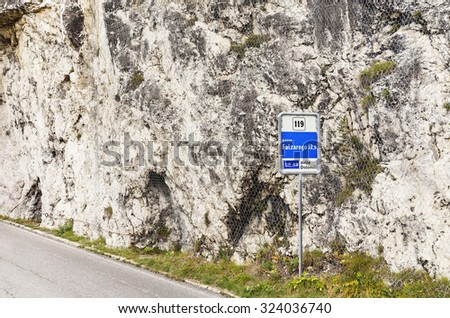 Routier sign Falzarego pass in Italy Dolomites mountains. - stock photo