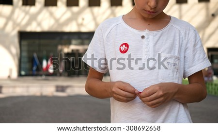 ROVERETO, ITALY - JULY 23, 2015: Mart Museum sticker on kid's T-shirt. The Museum of Art of Trento and Rovereto (MART) contains mostly modern and contemporary artworks.  - stock photo