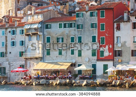 Rovinj, Croatia, 12 JULY 2012: Morning view on old town Rovinj from harbor with outdoor restaurants, Croatia